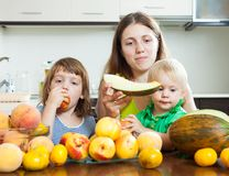 Mother with daughters with peaches Stock Photo