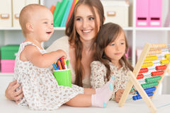 Mother and daughters playing at home Royalty Free Stock Photos