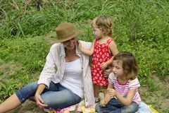 Mother and daughters playing outdoors Royalty Free Stock Image