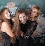 Mother with daughters. Portrait of a beautiful mother with her 2 daughters, studio shot Royalty Free Stock Image