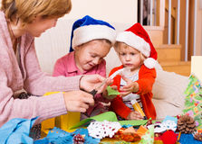 Mother with  daughters preparing for Christmas Stock Photography