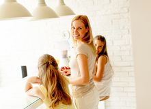 Mother and daughters preparing healthy smoothie stock photography