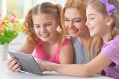 Mother with  daughters reading Royalty Free Stock Photo