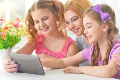 Mother with  daughters reading Stock Photo