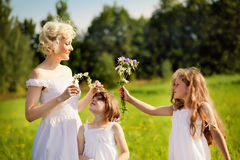 Mother and daughters relaxing Royalty Free Stock Photo