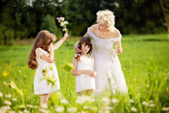 Mother and daughters relaxing Stock Photography