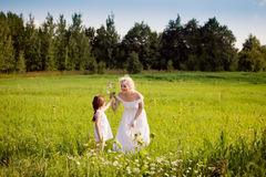 Mother and daughters relaxing on the meadow Royalty Free Stock Photos