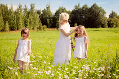 Mother and daughters relaxing on the meadow Stock Images