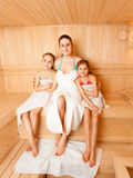Mother with daughters relaxing at steam bath Stock Photos