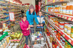 Mother and daughters shopping in grocery store Stock Photography
