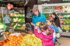 Mother and daughters shopping in grocery store Royalty Free Stock Image