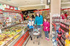 Mother and daughters shopping in grocery store Royalty Free Stock Photos