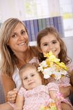 Mother and daughters smiling happily Stock Photo