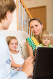 Mother and daughters with social worker Stock Photos