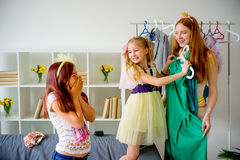 Mother and daughters try clothes Royalty Free Stock Photo