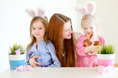Mother and daughters wearing bunny ears on Easter Stock Image