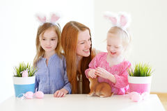 Mother and daughters wearing bunny ears on Easter Stock Photos