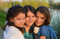 Mother and daughters. Young mother with her teen daughters Royalty Free Stock Photos
