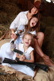 Mother and daughters. Young mother with two daughters sitting on hay ranch in the American royalty free stock images