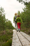 Mother and daughthter walking in forest Stock Image