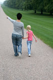 Mother and daugter. Walking in park Royalty Free Stock Images