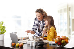 Mother and daugther baking together Royalty Free Stock Photography