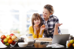 Mother and daugther baking together Stock Photos