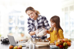 Mother and daugther baking together Royalty Free Stock Image