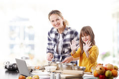 Mother and daugther baking together Royalty Free Stock Images