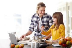 Mother and daugther baking together Stock Photo
