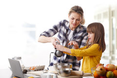 Mother and daugther cooking together Stock Photos