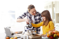 Mother and daugther cooking together Stock Image