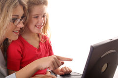 Mother & daugther looking at c. Shot of a mother & daugther looking at computer Royalty Free Stock Photos