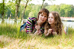 Mother and daugther relaxing in the grass Royalty Free Stock Image