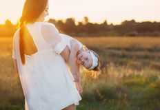 Mother and daugther at sunset Stock Photography