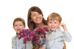 Mother Day. Portrait of adorable family - mother and two sons with flowers isolated on white Stock Photography