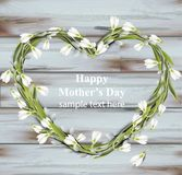 Mother day greeting card. Snowdrops heart wreath Spring card vector realistic illustration. wooden backgrounds. Mother day greeting card. Snowdrops heart wreath Stock Photos