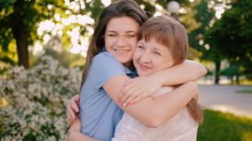 Mother day greeting happiness joy daughter mom. Mother day. Greeting happiness joy. Loving daughter hugging kissing mom smiling stock video