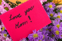 Mother day greeting, love you mom, handwritten. Stock Photos