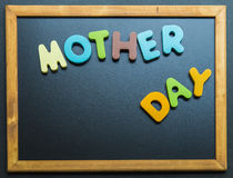Mother day wooden word on black board Stock Images