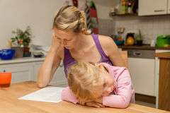 A mother disregard her daughter. A mother disregard her tired little daughter Stock Photography