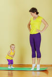 Mother do exercises with her daughter Stock Photography