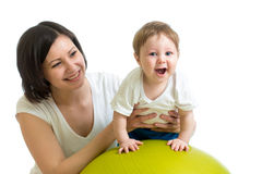 Mother do gymnastics with baby on fitness ball Stock Image