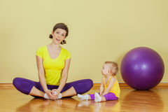 Mother do phisical exercises with her daughter Royalty Free Stock Photo