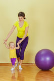 Mother do phisical exercises with her daughter at home Stock Images