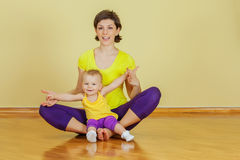 Mother do phisical exercises with her daughter at home Royalty Free Stock Image
