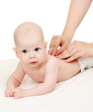 Mother or doctor massaging her baby boy Stock Images