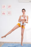 Mother does gymnastics with her baby Royalty Free Stock Photography