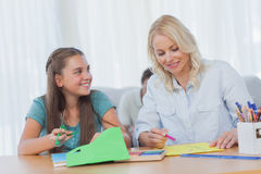 Mother doing arts and crafts with her daughter Royalty Free Stock Photo