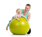 Mother doing gymnastics baby on fitness ball. Mother doing gymnastics with baby on fitness ball Royalty Free Stock Image